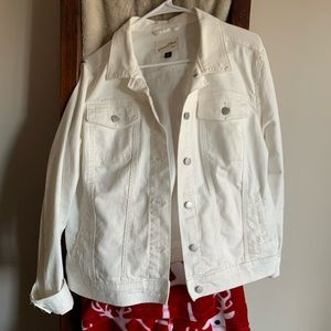 Long sleeve white jean jacket .